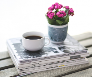 Decorative image of Coffee, news and a pot of flowers